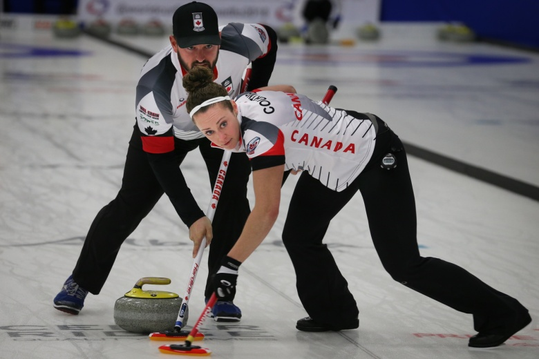 Team canada playing doubles curling